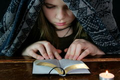 Young Girl Studies Bible 1 Royalty Free Stock Image