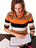 Young Girl Studies Her Notebooks Stock Photo