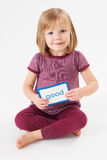 Young Girl In Studio Learning To Read Using Flash Card Stock Photo