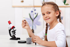Young girl study plants in biology class Royalty Free Stock Photos