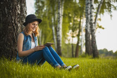 Young girl study with tablet in park Royalty Free Stock Photo