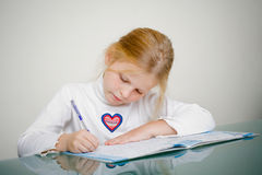 Young girl is studying Royalty Free Stock Photography