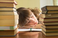 Young girl studying with books. Student sleeping d Royalty Free Stock Images