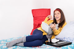 Young girl studying in her room Royalty Free Stock Image