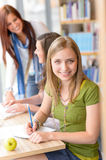 Young girl studying at high school library Royalty Free Stock Images