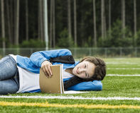 Young Girl Studying Outdoors Stock Photography