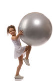 A young girl stuffed ball Royalty Free Stock Images