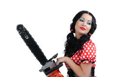 Young girl in style pinup with electric saw Stock Photo