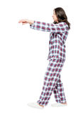 Young girl suffering from sleepwalking in a dream, portrait. In full length on a white background Stock Photography