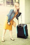 Young girl with suitcase at airport Royalty Free Stock Image