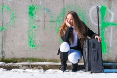 Young girl with a suitcase Royalty Free Stock Photo