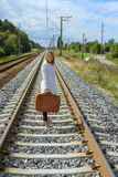 Young girl with suitcase at railways Royalty Free Stock Photo