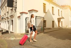 Young girl with a suitcase. Vacation concept. Royalty Free Stock Photo