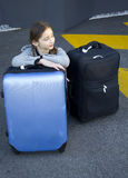 Young girl with suitcases Stock Image