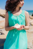 Young girl on summer beach with shell Royalty Free Stock Photography