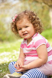 Young Girl In Summer Dress Sitting In Field Royalty Free Stock Photo
