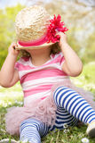 Young Girl In Summer Dress Sitting In Field Stock Images