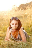 Young girl in summer field Royalty Free Stock Images
