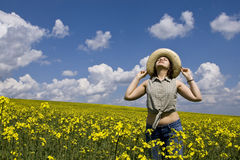 Young girl in summer field. Young attractive girl enjoying spring Stock Photo