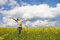 Young girl in summer field royalty free stock photo