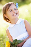 Young Girl In Summer Field Holding Sunflower Royalty Free Stock Image