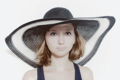 Young girl in  summer hat Stock Image
