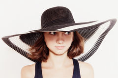 Young girl in summer hat closeup Stock Photography