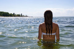 Young girl in summer sea Stock Image