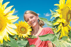 Young girl with sun flowers Stock Photo