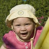 Young girl with sun hat. Is calling Royalty Free Stock Image