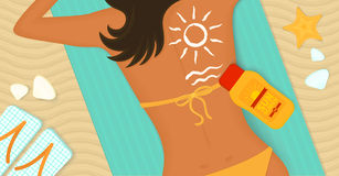 Young girl sunbathes on a beach Royalty Free Stock Images