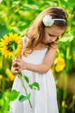 Young girl with sunflower Stock Photo