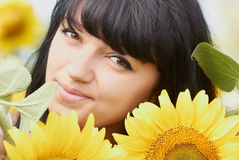 Young girl with sunflowers outdoors Stock Photography
