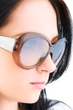Young girl with sunglasses Royalty Free Stock Photos