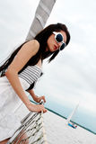 The young girl in sunglasses Stock Photos