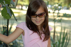 Young Girl with Sunglasses Stock Images