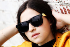 A young girl in sunglasses royalty free stock photography