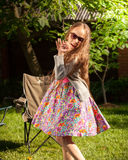 Young girl in sunglasses dancing at yard Royalty Free Stock Images