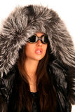 The young girl in sunglasses and a fur hood Royalty Free Stock Photo
