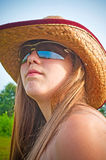Young girl with sunglasses and hat Stock Photography