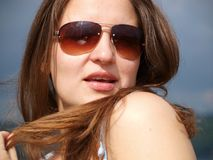 Young girl in sunglasses stock photo