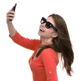 Young girl in sunglasses make self portrait selfie with her mobi Royalty Free Stock Image