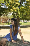 Young girl with sunglasses on park bench Royalty Free Stock Photo