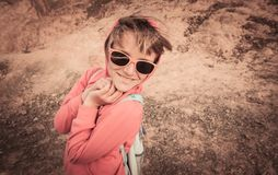 Young girl in sunglasses smiles and laughs at camera stock image