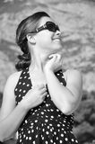 Young girl with sunglasses is smiling. Young beautiful girl smile in black and white Royalty Free Stock Images