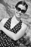 Young girl with sunglasses is smiling. Young beautiful girl smile in black and white Royalty Free Stock Image