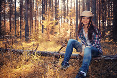 Young girl in sunny forest stock photography