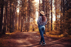 Young girl in sunny forest Royalty Free Stock Photography