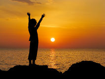 Young girl at sunrise Stock Image