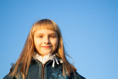 Young girl in the sunset light Royalty Free Stock Photography